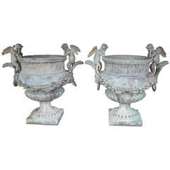 Pair of Verde Patinated Large Bronze Planters with Winged Cherubs and Garland